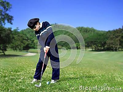 Junior golfer swing
