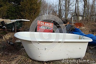 Junked bath tub