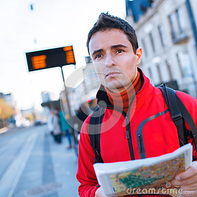 Free Just Arrived: Handsome Young Man Studying A Map On A Bus Stop Royalty Free Stock Images - 30234679