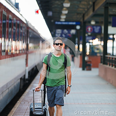 Free Just Arrived: Handsome Young Man Walking Along A Platform Royalty Free Stock Photos - 30234628