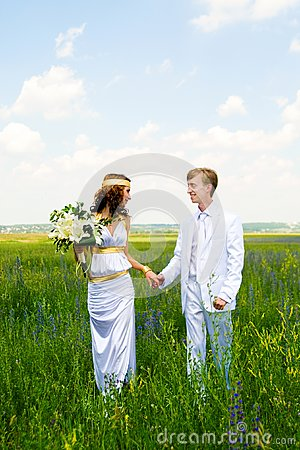 Just married couple on field