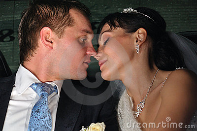 Just married couple is kissing
