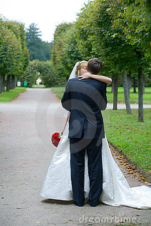 Just Married Couple Kissing In The Park