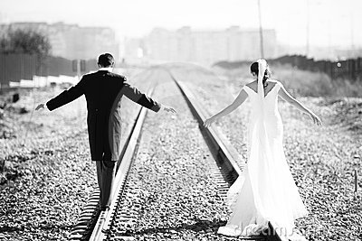 Just married couple on railway