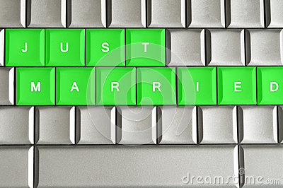 Just Married spelled on a metallic keyboard