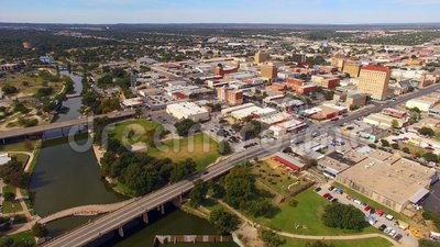 Aerial View Moving over The River in Downtown San Angelo West Texas. Just slight traffic on the weekend in the aerial view of San Angelo Texas USA stock footage