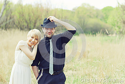 Just wedded couple dressed in retro
