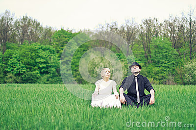 Just wedded couple sitting in the garden