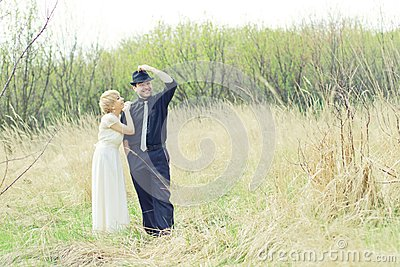 Just wedded young couple dressed retro