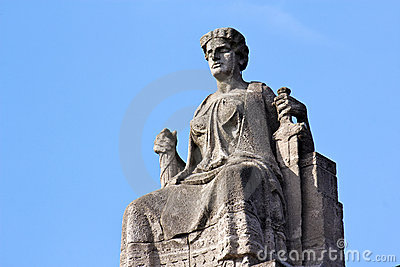 Justitia on Her Throne before a Clear Blue Sky