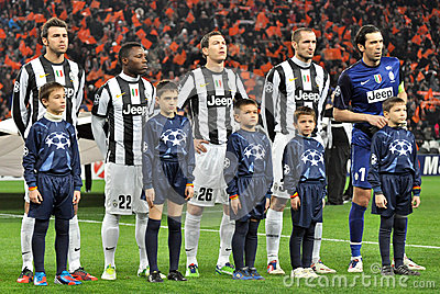 Juventus players with small boys listen anthem Editorial Image
