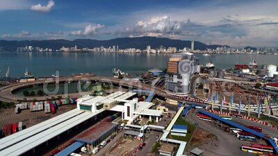 4k Aerial view Penang ferry operates between Butterworth on the Malaysia Peninsula and Georgetown on the Island of Penang Island. Aerial view Penang ferry stock video footage