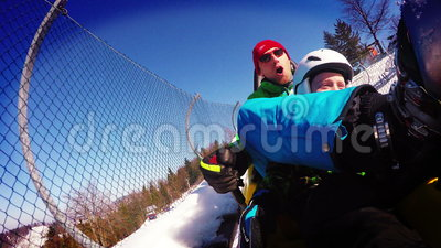 4K Footage: Father and son on the Bobsleigh attraction during winter holiday. stock video