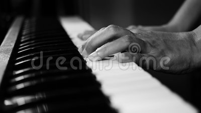 4K footage of piano music pianist hands playing monochrome black and white color. musical instrument grand piano selective focus. With depth of field stock footage