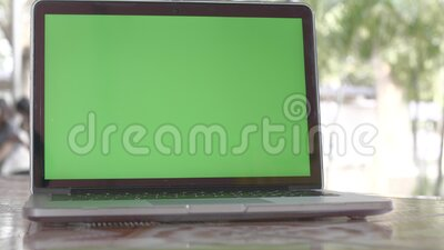 4K Green screen of laptop computer set on working space stock footage