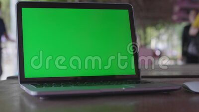 4K Green screen of laptop computer set on working space stock video footage