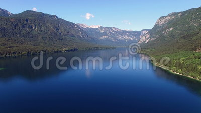 4K. High flight and takeoff above amazing Bohinj Lake in the morning. Blue deep water and Julian Alps mountains. Triglav NP. 4K. High flight and takeoff above stock footage