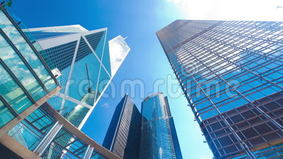 4k timelapse video of office buildings with reflection of clouds. 4k timelapse video of office buildings in Hong Kong with reflection of clouds