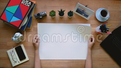4K. loop of creative occupation hand flip on blank sketch paper stack on working desk over on right side with delay on each page. Top view stock footage