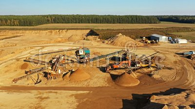 4K. Sand quarry in working process with heavy machinery: sorting conveyor, bulldozers, excavators and trucks stock footage
