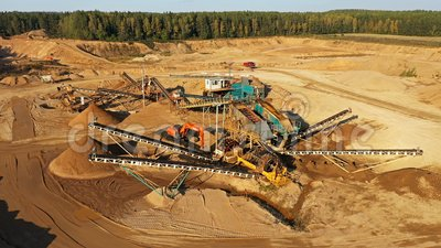 4K. Sand Quarry in working process with heavy machinery: sorting conveyor, bulldozers, excavators and trucks stock video
