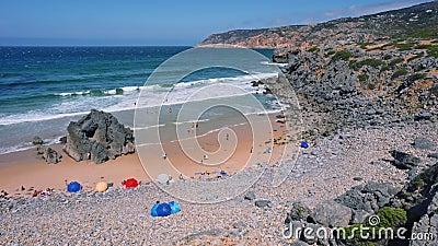 4K small Praia do Abano tourism beach surrounded by sandy dunes. Atlantic coastline travel concept. Cascais, Portugal.  stock video