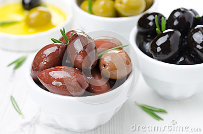 Kalamata olives in a bowl close-up, horizontal