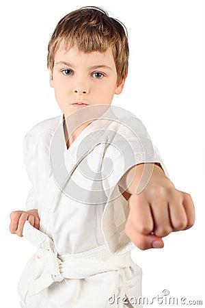 Karate boy in white kimono fighting isolated