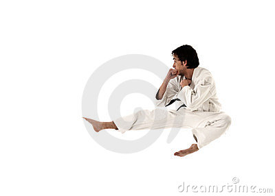 Karate flying kick young male fighter isolated