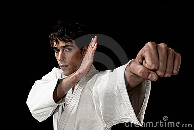 Karate male fighter close-up high contrast black