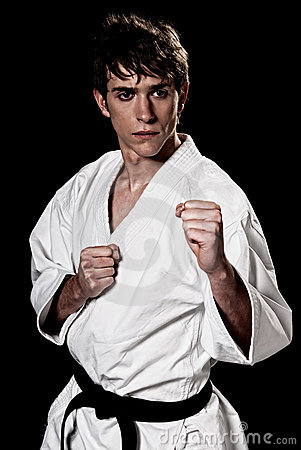 Karate male fighter young high contrast on black