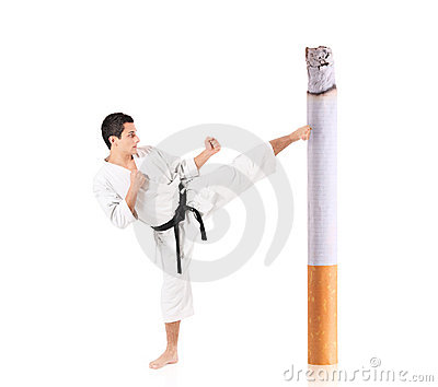 Karate man hitting a cigarette