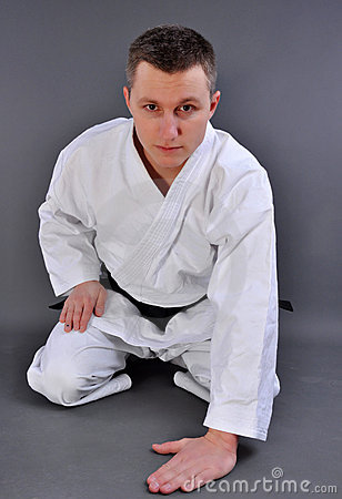 Karate man in relaxation pose