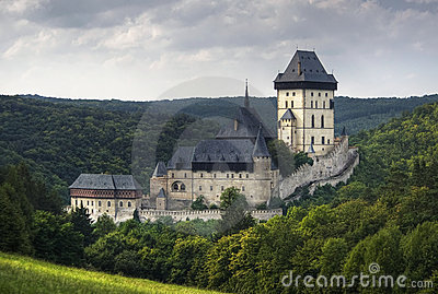 Karlstein castle on cloudy sky