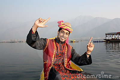 Kashmiri Boy Dancing to a Folk Song on a Shikara