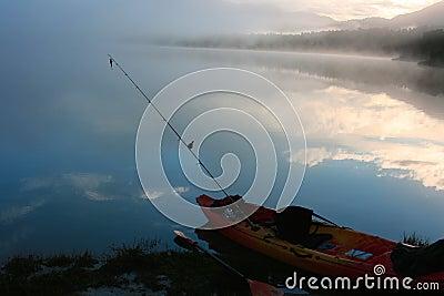 Kayak fishing at sunrise