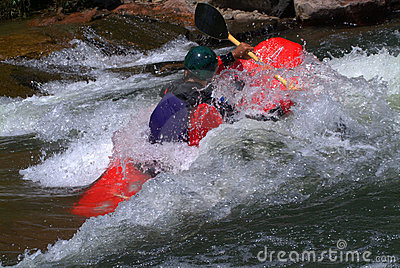 Kayak paddling in rapids