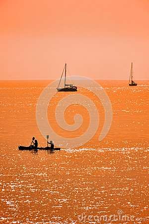 Kayak and sailboats