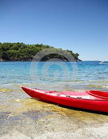 Kayak on the shore of the turquoise sea