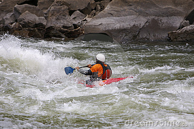 Kayaker battling rapids