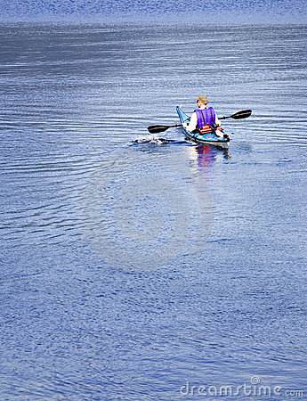 Kayaker paddling on lake