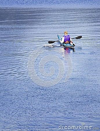 Kayaker paddling on lake