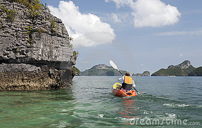 Kayaker Paddling in the Tropics