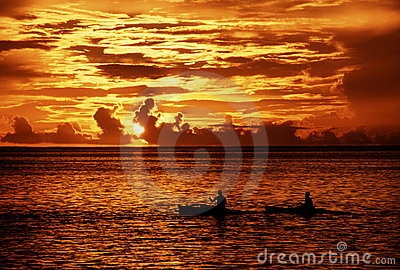 Kayakers at sunset