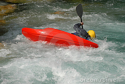 Kayaking on the rapids of river