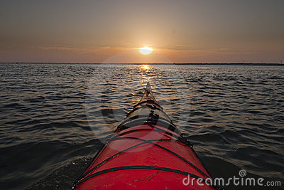 Kayaking into sunrise
