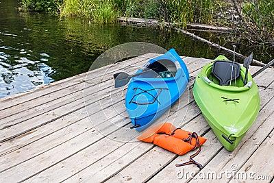 Kayaks and Life Jacket on Fishing Pier