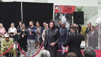 Keanu Reeves. Actor`s handprints and footprints cemented on Hollywood Boulevard. Chinese Theater Event, Guests, Celebrities, Halle Berry, Laurence Fishburne