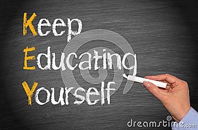 Keep Educating Yourself Words on Blackboard