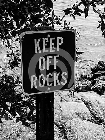 Free Keep Off The Rocks In Black And White Stock Photography - 102302112